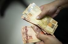 Auxílio é pago a beneficiários do Bolsa Família com NIS 2