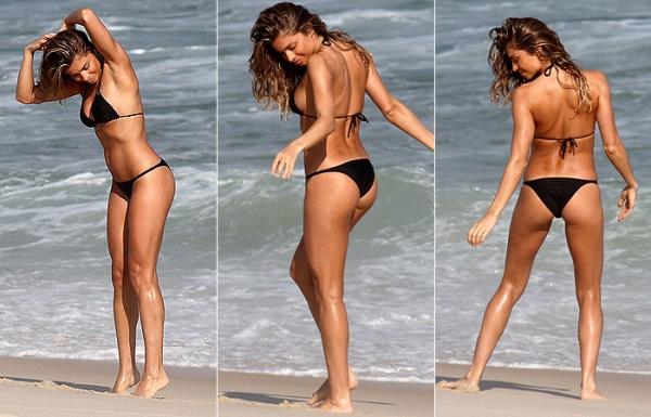 Atriz Grazi Massafera posa para fotos em praia do Rio