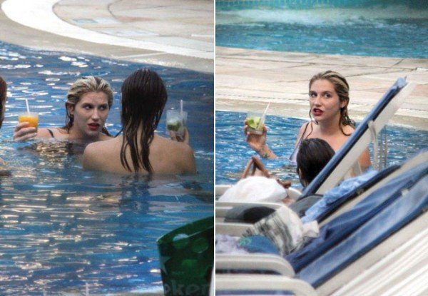 Ke$ha é fotografada beijando rapaz e amiga na piscina de hotel