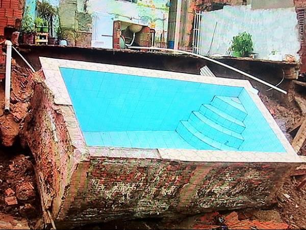 Piscina construída em área de risco em Cuiabá desaba após temporal