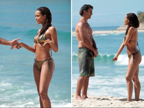Taís Araújo e Marcos Pasquim exibem boa forma em gravação na praia
