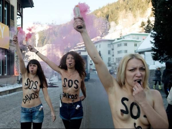 Ativistas protestam seminuas no Fórum Econômico Mundial