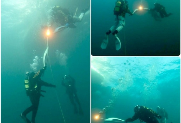 Tocha olímpica de Sochi 2014 é  levada para fundo de lago na Sibéria