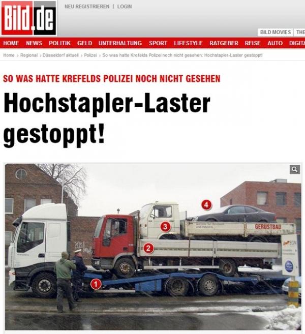 Foto mostra caminhão que leva caminhão que leva caminhão e carro