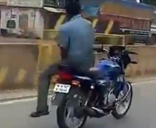 Homem faz manobra perigosa ao andar em