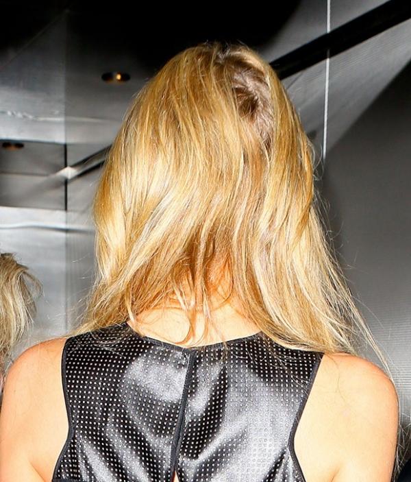 Paris Hilton aparece com cabelo desgrenhado e feio após viagem