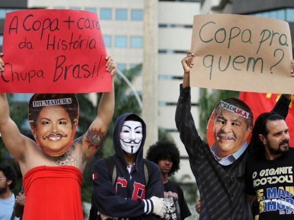 Temor da Fifa, protestos movimentam sedes em 1º ato contra a Copa do ano