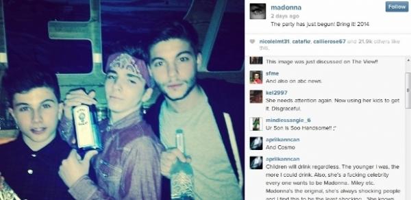Madonna é criticada por foto do filho de 13 anos com garrafa de bebida