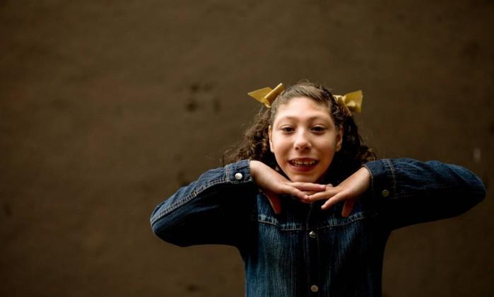 Isabelly nasceu com microcefalia e hoje tem 12 anos (Crédito: Reproduçao)