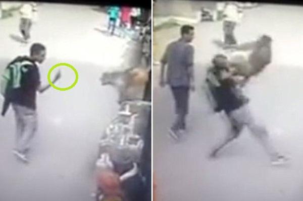 Após o impacto, o homem cai no chão e fica atordoado com o golpe
