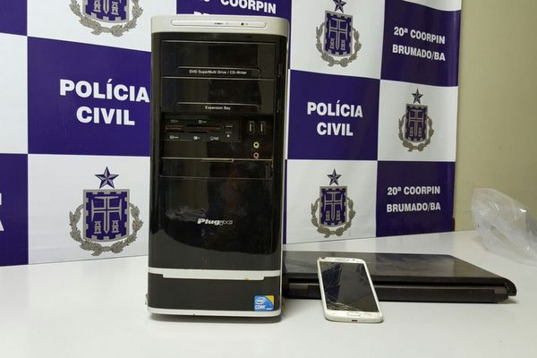 Polícia apreendeu um celular e um computador com acusado  (Crédito: Divulgação/ Polícia Civil )