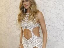 Luana Piovani usa vestido ousado para lançamento de ensaio nu