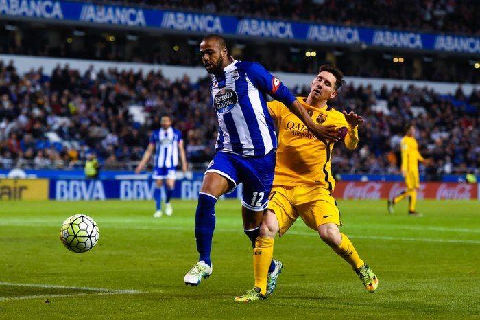 Zagueiro disputa jogada com Messi