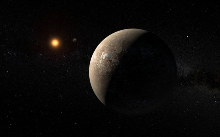 Ilustração mostra o planeta Proxima b orbitando ao redor da anã vermelha Proxima Centauri, vizinha mais próxima do Sol  (Crédito: Reprodução)