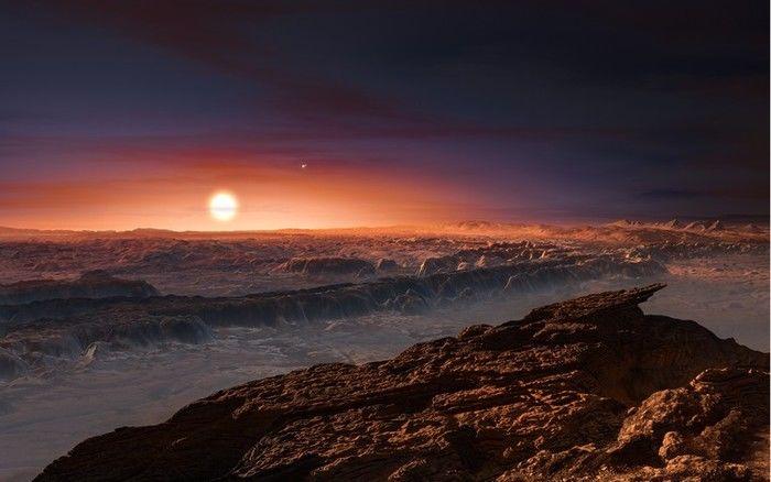 Ilustração mostra como pode ser a superfície do planeta Proxima b, que orbita a estrela Proxima Centauri, a mais próxima do Sol (Crédito: Reprodução)