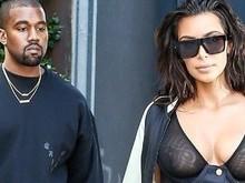 Sem sutiã, Kim Kardashian deixa seios expostos e impressiona