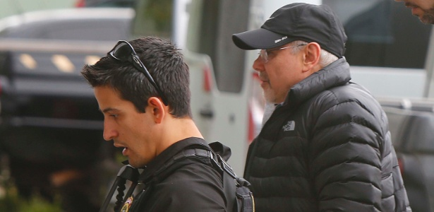 Guido Mantega (de boné) foi preso em um hospital (Crédito: Estadão Conteúdo)
