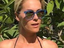 Ana Hickmann mostra barriga sarada em dia de piscina