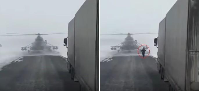 Helicóptero pousa em estrada e piloto desce para pedir informação