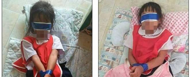 Crianças são vendadas e têm as mãos atadas como punição