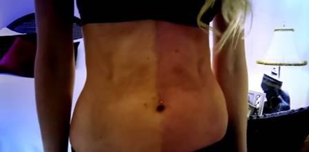 A barriga de Taylor com dois tons de pele (Crédito: Reprodução)