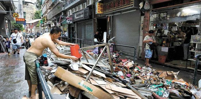 Cidade destruída após tufão (Crédito: T.Siu/Reuters)