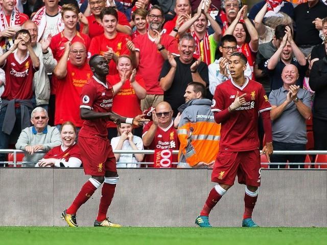 Firmino volta a marcar, ataque brilha, e Liverpool goleia o Arsenal