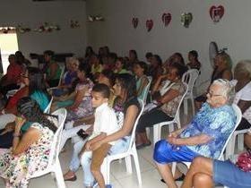 Mulheres participam de palestra sobre o dia 8 de março