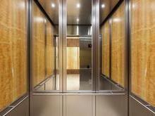 Saiba o por que a maioria dos elevadores tem espelho dentro