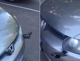 Motorista descobre pistola cravada no parachoque do seu carro