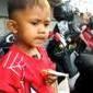 Criança de apenas 2 anos de idade fuma 40 cigarros por dia