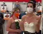 Mulher invade trabalho do namorado vestida de noiva para fazê-lo casar