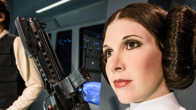 A Princesa Leia é uma das estátuas de cera do Museu Madame Tussaud, em Londres. O penteado de Leia, os vestidos, seu comportamento e a relação com Han Solo tornaram o personagem emblemático. / Getty images