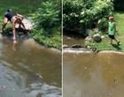 Mãe e filho invadem covil de jacarés para recuperar carteira; fotos