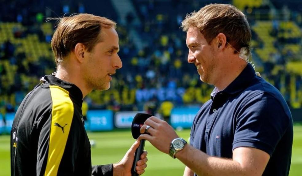 Tuchel e Nagelsmann, em um dos encontros que tiveram na Alemanha, quando Tomas dirigia do Dortmud, e Julian comandava o Hoffenheim — Foto: Bundesliga.com