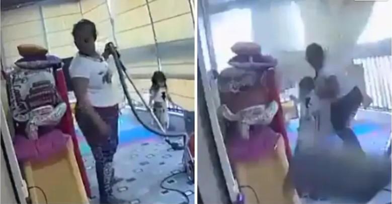 Mulher protege menina durante explosão - Foto: Reprodução