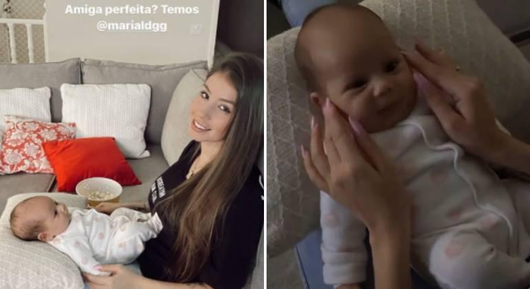 Maria Lina divulga foto segurando bebê. (Foto: