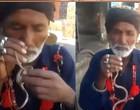 Vídeo chocante: homem insere cobra no próprio nariz e a puxa por sua boca