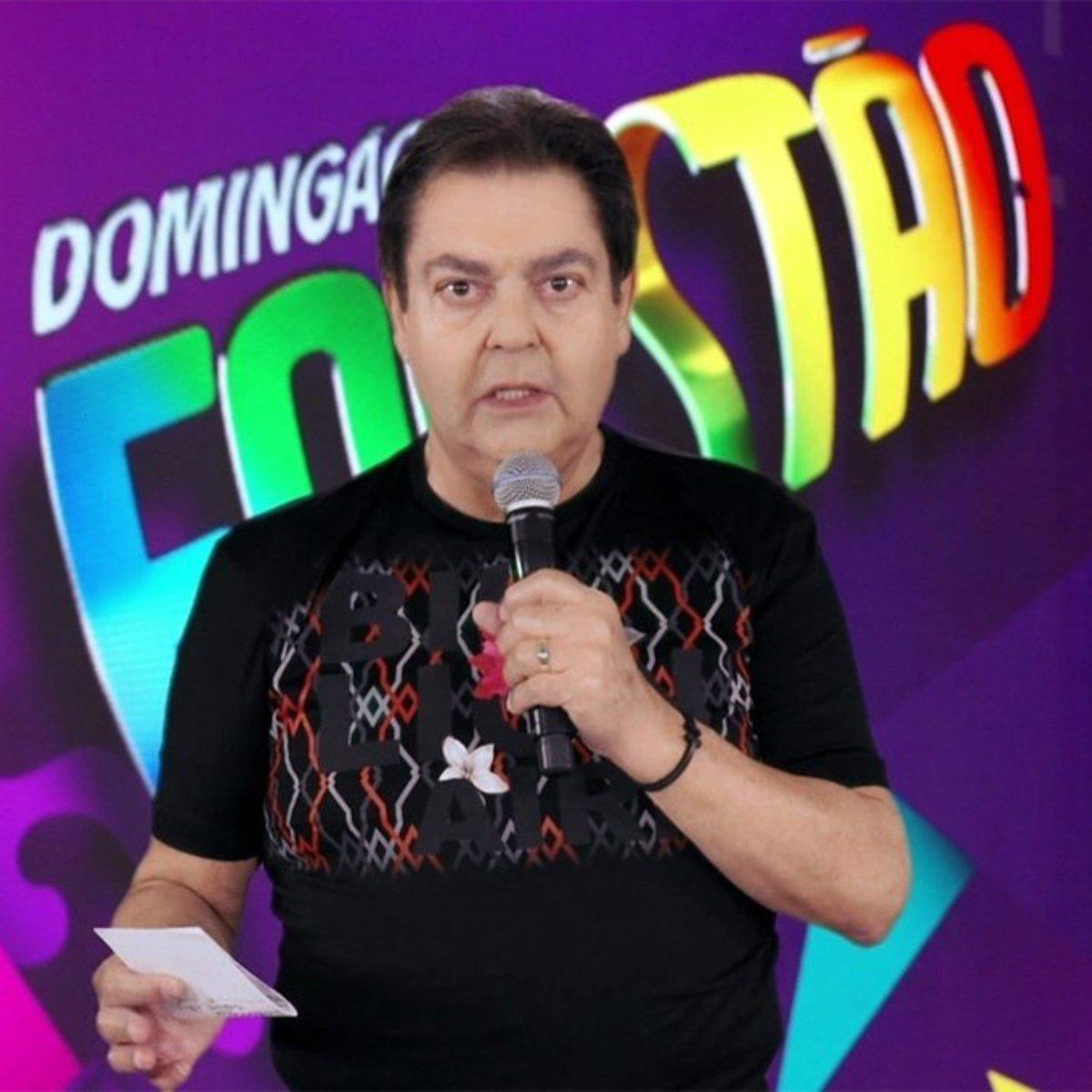 Faustão assinou contrato com a Band e está fora das telinhas já que ainda não encerrou seu contrato com a Globo